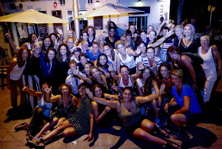 Large group of lesbians at night, smiling and celebrating - ELLA Festival Mallorca